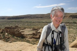 Sharon Gross standing on the cliff above the Cliff Palace overlook.